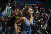 People attend a free outdoor event organized by The Broadway League during Juneteenth celebrations at Times Square on Saturday, June 19, 2021, in New York. Parades, picnics and lessons in history marked Juneteenth celebrations in the U.S., a day that marks the arrival of news to enslaved Black people in a Texas town that the Confederacy had surrendered in 1865 and they were free. (AP Photo/Eduardo Munoz Alvarez)
