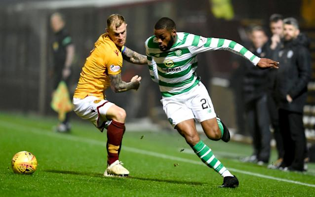 Motherwell's Richard Tait (left) and Celtic's Olivier Ntcham battle for the ball  - PA