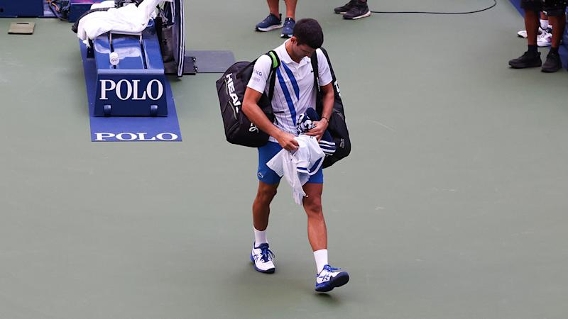 Novak Djokovic, pictured here leaving the court after being defaulted from the US Open.