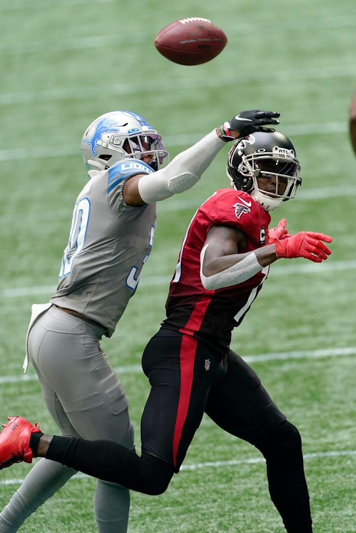 Lions cornerback Jeff Okudah breaks up a pass intended for Falcons receiver Julio Jones during the first half on Sunday, Oct. 25, 2020, in Atlanta.