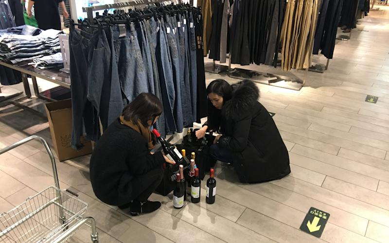 A pair of shoppers during the Beijing store's closing down sale - Credit: Neil Connor/Telegraph