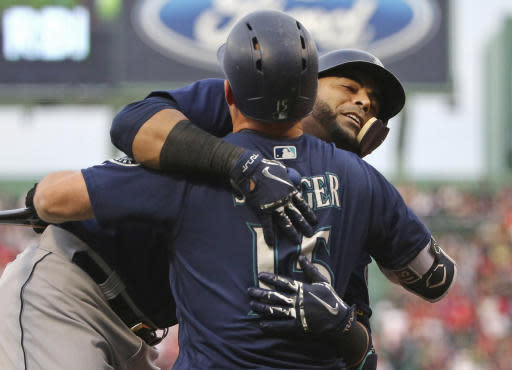 Seattle Mariners' Nelson Cruz, rear, celebrates his three-run home run with Kyle Seager (15) during the first inning of the team's baseball game against the Boston Red Sox at Fenway Park, Friday, June 22, 2018, in Boston. (AP Photo/Elise Amendola)