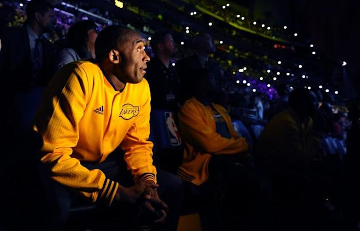 Lakers star Kobe Bryant watches a tribute video at Staples Center before the final game of his career on April 13, 2016.
