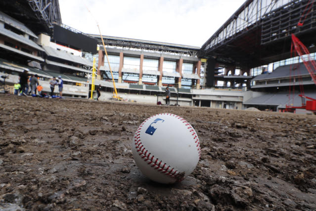 A baseball lies on packed dirt after for a short batting practice during a tour of the under construction baseball field at the new Texas Rangers stadium in Arlington, Texas, Wednesday, Dec. 4, 2019. (AP Photo/LM Otero)