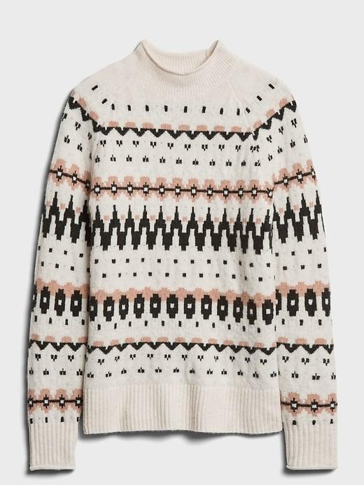 <p>Are you and your crew missing your annual ski trip? Make some hot cocoa with Schnapps and slip on this après-ski style <span>Banana Republic Fair Isle Mock-Neck Sweater</span> ($110) to get in the spirit!</p>