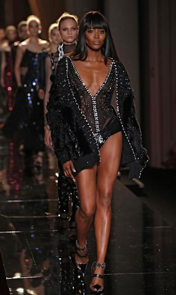 Naomi Campbell wears a creation by fashion designer Donatella Versace during her Women's Fall Winter 2013 haute couture fashion collection in Paris, France, Sunday, June 30, 2013. (AP Photo/Jacques Brinon)
