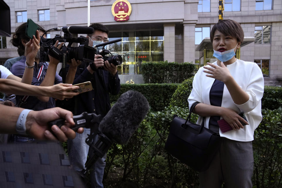 Teresa Xu speaks to journalists before a court session at the Chaoyang People's Court in Beijing, China, Friday, Sept. 17, 2021. After almost two years, the unmarried woman suing for the right to freeze her eggs in Beijing is getting her case heard in court Friday in a rare legal challenge against the country's restrictions on unmarried women in reproductive health. (AP Photo/Ng Han Guan)