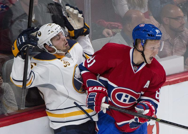 Montreal Canadiens' Lars Eller, right, collides with Buffalo Sabres' Patrick Kaleta during the second period of an NHL pre-season hockey game, Sunday, Sept. 15, 2013 in Montreal. (AP Photo/The Canadian Press, Graham Hughes)