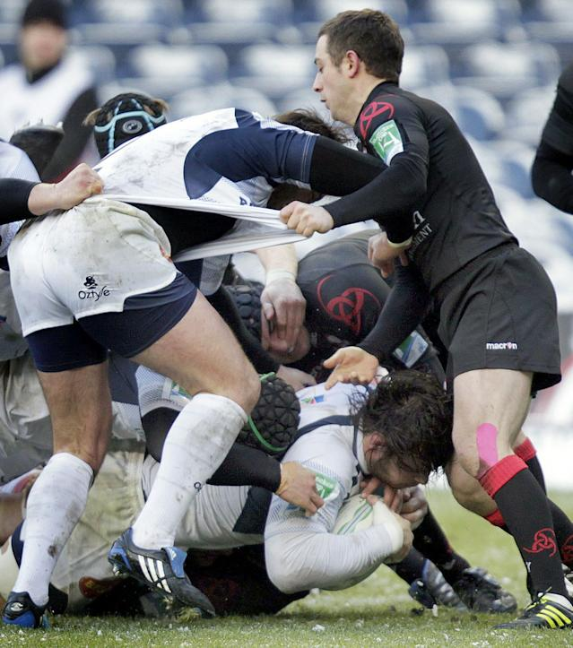 Rodrigo Capo Ortega (Below) of French rugby club Castres, scores a try against Scottish team Edinburgh during a Heineken Cup, pool one, rugby union match at Murrayfield, Edinburgh, Scotland, on December 20, 2010. The game was postponed Sunday due to bad weather. AFP PHOTO/GRAHAM STUART (Photo credit should read GRAHAM STUART/AFP/Getty Images)