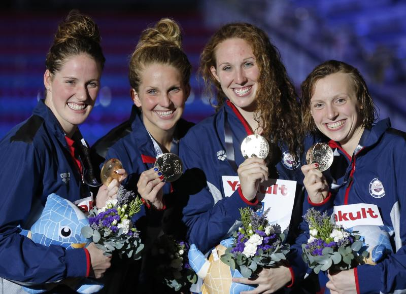 The United States team, from left: Missy Franklin, Karlee Bispo, Shannon Vreeland and Katie Ledecky smile as they pose with their gold medals that they won in the Women's 4x200m freestyle relay final at the FINA Swimming World Championships in Barcelona, Spain, Thursday, Aug. 1, 2013. (AP Photo/Daniel Ochoa de Olza)