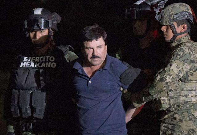 """On Jan. 8, 2016, Mexican drug lord Joaquin """"El Chapo"""" Guzman was escorted by soldiers to a helicopter in Mexico City when he was captured after breaking out of a maximum-security prison. (Photo: Rebecca Blackwell/AP)"""