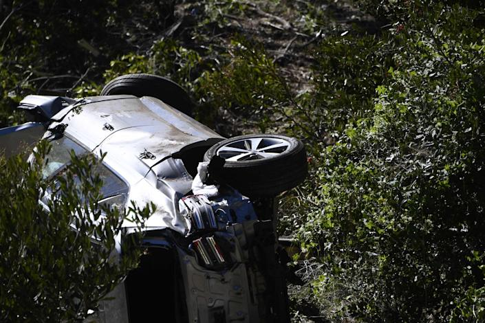 Tiger Woods' vehicle was tipped on its side in Rancho Palos Verdes, Calif.
