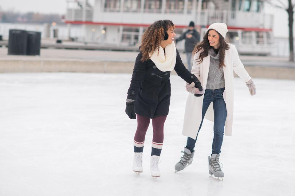 """<h1 class=""""title"""">Adult Female Couple Ice Skating</h1><cite class=""""credit"""">FatCamera</cite>"""