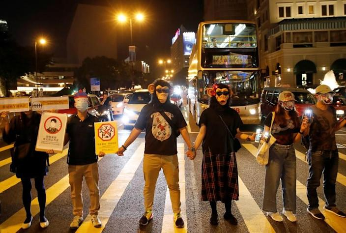People wearing masks gather during an anti-government protest in Hong Kong