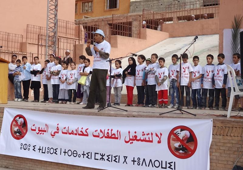 """In this  Aug. 2011 photo made available Thursday, Nov. 15, 2012 and provided by the INSAF association shows a meeting against the use of under-15 aged girls as domestic servant, with  a banner reading in Arabic """"No the work of young girls as domestic servants""""  in Imintanoute, southwest of Marrakech, Morocco. In a report issued Thursday, Human Rights Watch group followed up on its 2005 study that found how tens of thousands of girls under the age of 15 work as maids, often subject to abuse, with no access to education. The Moroccan government has said the number of minors involved in child labor has dropped by nearly 80 percent since 1999 thanks to public awareness campaigns and enforcement of existing laws. (AP Photo/ INSAF)"""