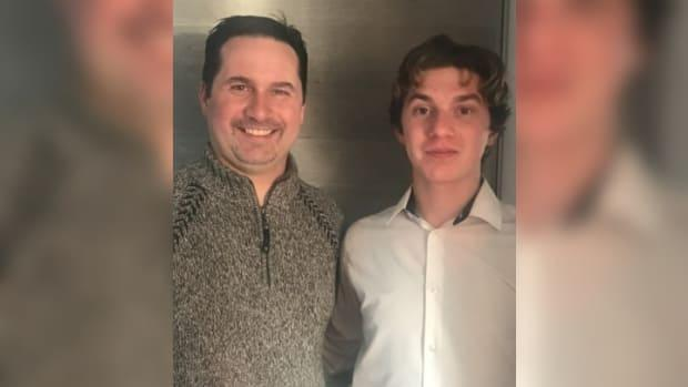 Gary Parker, left, would normally travel every weekend from Edmundston to see his son, Matthew Parker, play in games. This season, he hasn't been able to do that due to COVID-19 restrictions.