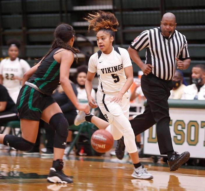 Pinkston guard Victoria Flores (5) drives the ball against Kennedale guard Reagan Jackson (3) during the first half of a 4A Region 2 quarterfinal basketball game at DeSoto High School in DeSoto, Texas, Wednesday, Feb. 24, 2021. Pinkston led Kennedale 19-11 at the half. (Special to the Star-Telegram Bob Booth)