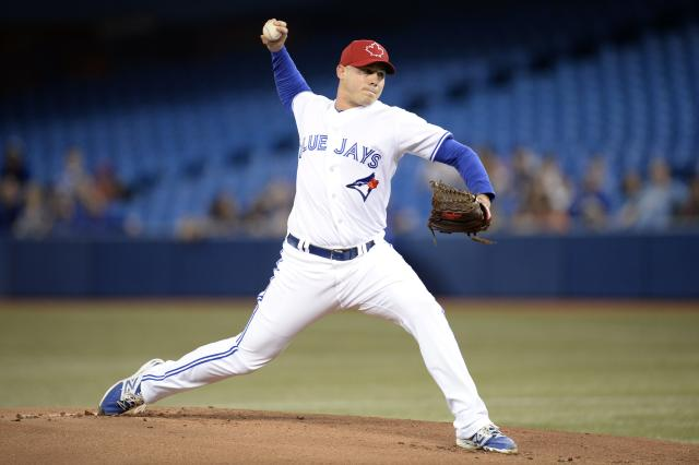 Toronto Blue Jays starting pitcher Dustin McGowan throws against the Los Angeles Angels during the first inning of a baseball game in Toronto on Friday, May 9, 2014. (AP Photo/The Canadian Press, Frank Gunn)