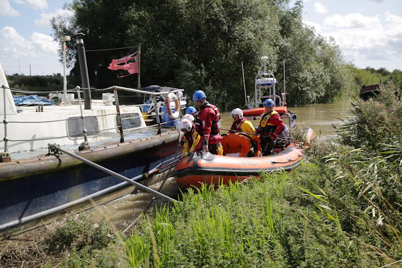 Search crews on the River Stour during the hunt for Lucas Dobson. (SWNS)