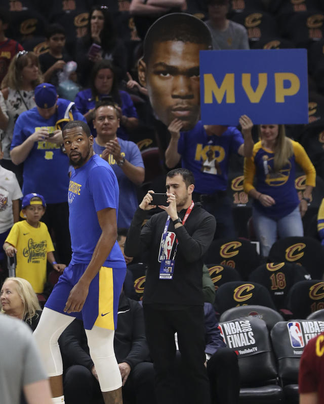 <p> Fans cheer for Golden State Warriors forward Kevin Durant (35) as he warms up for Game 4 of basketball's NBA Finals between the Warriors and the Cleveland Cavaliers, Friday, June 8, 2018, in Cleveland. (AP Photo/Carlos Osorio) </p>