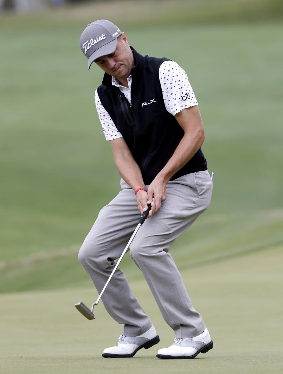 Justin Thomas reacts as he misses a putt on the fifth hole during round-robin play at the Dell Technologies Match Play Championship golf tournament, Friday, March 29, 2019, in Austin, Texas. (AP Photo/Eric Gay)