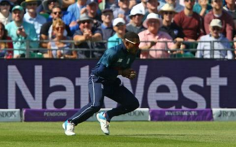 England's Chris Jordan reacts as he catches the ball to take the wicket of Pakistan's Sarfraz Ahmed - Credit: GEOFF CADDICK/AFP/Getty Images