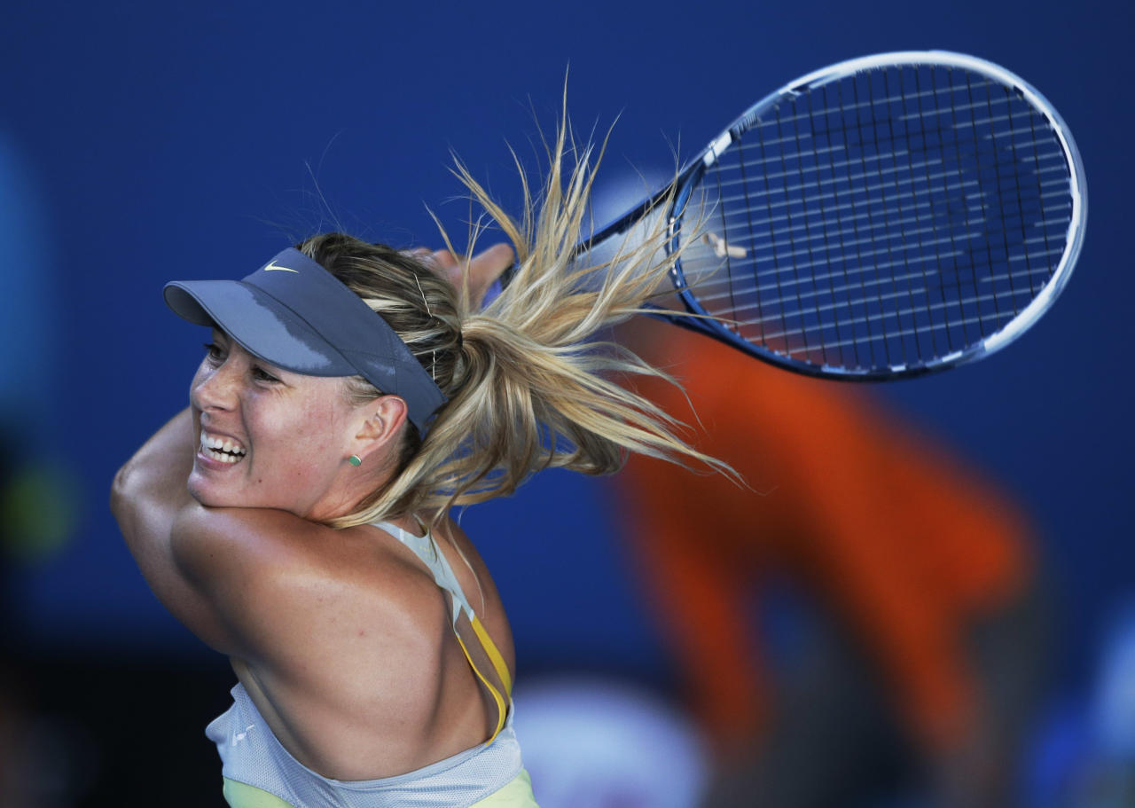 Russia's Maria Sharapova hits a return to Japan's Misaki Doi during their second round match at the Australian Open tennis championship in Melbourne, Australia, Wednesday, Jan. 16, 2013. (AP Photo/Rob Griffith)
