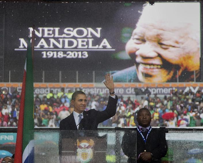 In this Dec. 10, 2013, photo, President Barack Obama waves as he arrives to speak at the memorial service for former South African president Nelson Mandela at the FNB Stadium in the Johannesburg, South Africa township of Soweto. South Africa's deaf federation said on Wednesday that the interpreter on stage for Mandela memorial was a 'fake', (AP Photo/Evan Vucci)