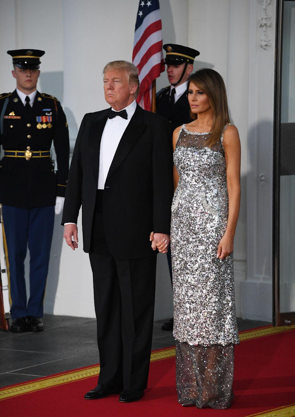 For her debut state dinner at the White House, Melania Trump donned a sheer-effect dress hot from the runway. Perhaps a subtle tribute to French guests Emmanuel and Brigitte Macron, the First Lady donned a Chanel haute couture gown. Meanwhile, Brigitte opted for custom Louis Vuitton. [Photo: Getty]