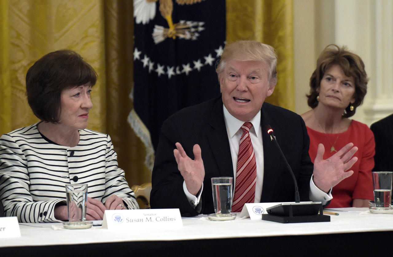 <p> President Donald Trump, center, speaks as he meets with Republican senators on health care in the East Room of the White House in Washington, Tuesday, June 27, 2017. Sen. Susan Collins, R-Maine, left, and Sen. Lisa Murkowski, R-Alaska, right, listen (AP Photo/Susan Walsh) </p>