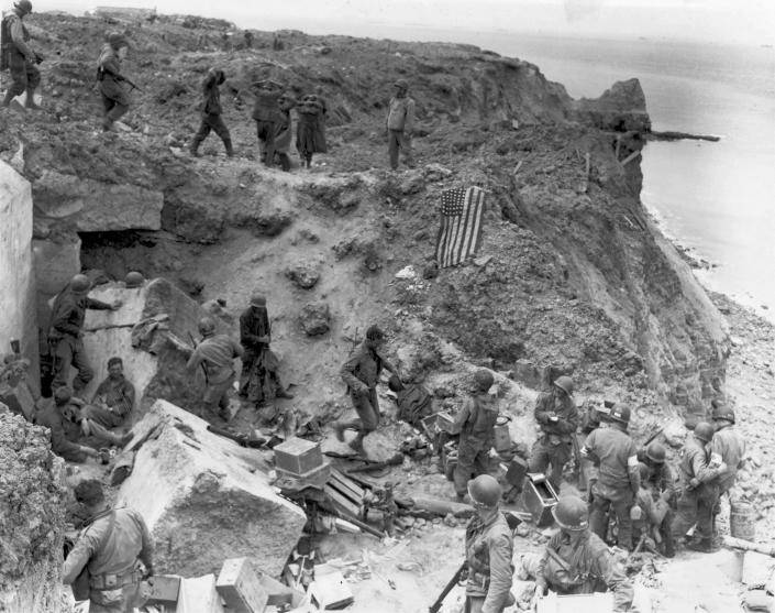 A U.S. flag lies as a marker on a destroyed bunker two days after the strategic site overlooking D-Day beaches was captured by U.S. Army Rangers at Pointe du Hoc, France, on June 8, 1944. The gun emplacement was captured by seaborne Rangers, who arrived in the early hours of D-Day to find that the German artillery it housed had been moved inland. The guns were later located and destroyed. (Photo: U.S. National Archives/handout via Reuters)