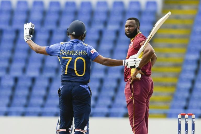 Dhanushka Gunathilaka of Sri Lanka, who was given out obstructing the field, remonstrates with West Indies bowler Kieron Pollard