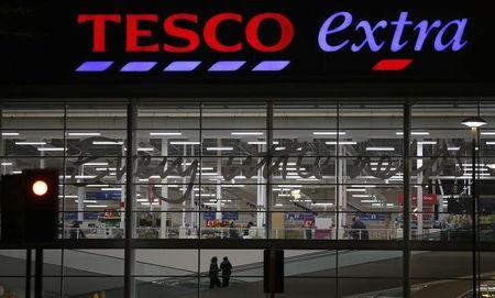 Shoppers arrive at a Tesco superstore in Altrincham, northern England