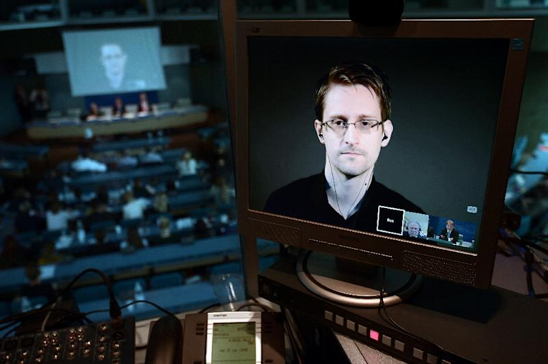 """Edward Snowden is seen via live video link from Russia on a computer screen during a parliamentary hearing on the subject of """"Improving the protection of whistleblowers"""", on June 23, 2015, at the Council of Europe in Strasbourg"""