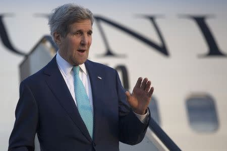 U.S. Secretary of State John Kerry waves as he arrives in Sharm el-Sheikh March 13, 2015, to participate in the Egypt Economic Development Conference. REUTERS/Brian Snyder