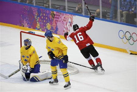 Canada's Jonathan Toews (16) scores on Sweden's goalie Henrik Lundqvist as Sweden's Patrik Berglund (C) reacts during the first period of the men's ice hockey gold medal game at the 2014 Sochi Winter Olympic Games, February 23, 2014. REUTERS/Jim Young