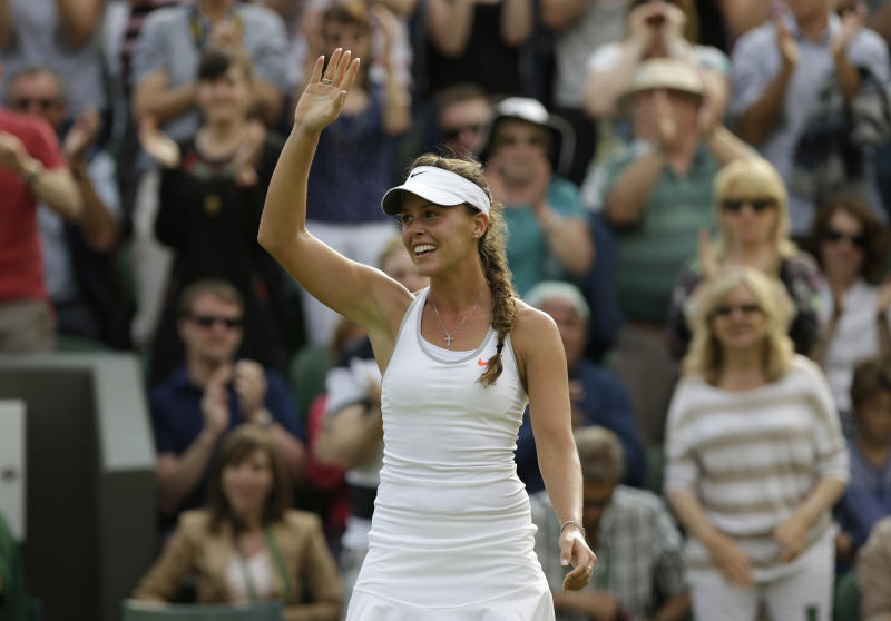 Michelle Larcher De Brito of Portugal reacts after beating Maria Sharapova of Russia during their Women's second round singles match at the All England Lawn Tennis Championships in Wimbledon, London, Wednesday, June 26, 2013. (AP Photo/Anja Niedringhaus)
