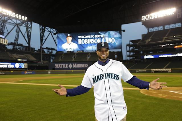 Robinson Cano poses for a photo in his new jersey at Safeco Field after he was introduced as the newest member of the Seattle Mariners baseball team, Thursday, Dec. 12, 2013, in Seattle. (AP Photo/Ted S. Warren)