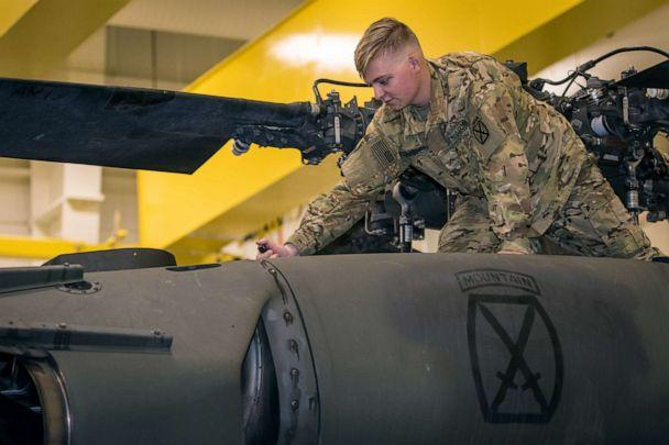 PHOTO: Army Pvt. Hunter Nines opens a UH-60L Blackhawk helicopter engine bay cowling to conduct fuel checks during routine inspections at Fort Drum, N.Y. on Oct. 4, 2019. (US Army)