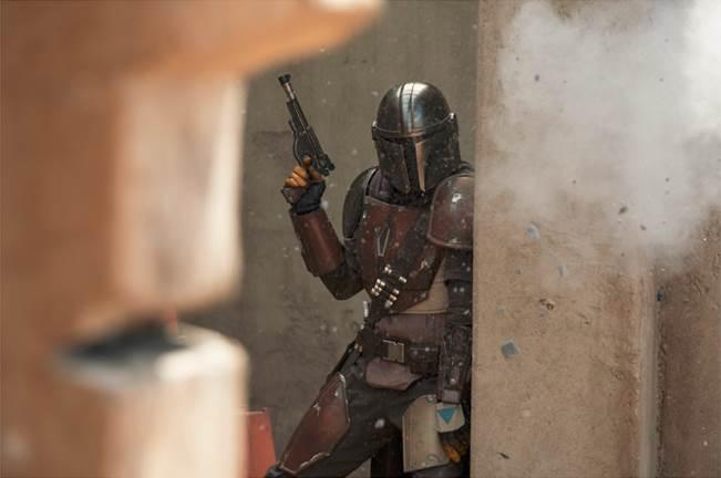 Pedro Pascal takes cover from some heavy firepower in the new Disney+ 'Star Wars' series 'The Mandalorian' (Photo: François Duhamel/Lucasfilm Ltd.)