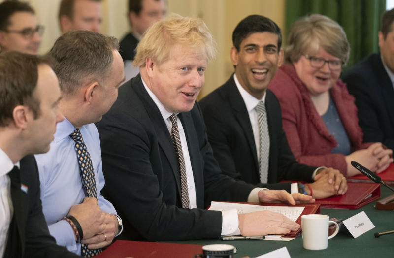 LONDON, ENGLAND - FEBRUARY 14: British Prime Minister Boris Johnson speaks during his first Cabinet meeting flanked by his new Chancellor of the Exchequer Rishi Sunak, fourth left, after a reshuffle the day before, inside 10 Downing Street, at Downing Street on February 14, 2020 in London, England. The Prime Minister reshuffled the Cabinet yesterday. High profile changes were Attorney General Geoffrey Cox, Business Secretary Andrea Leadsom, Housing Minister Esther McVey and Northern Ireland Minister Julian Smith all sacked and Chancellor Sajid Javid resigned. (Photo by Matt Dunham - WPA Pool/Getty Images)