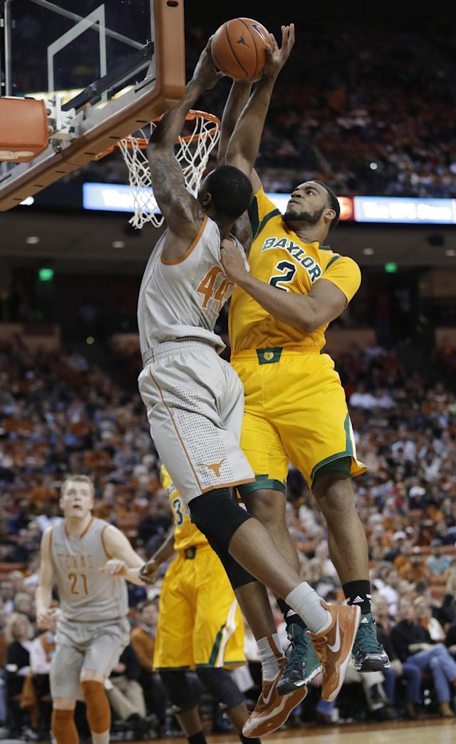 Texas' Prince Ibeh (44) is blocked by Baylor's Rico Gathers (2) during the first half of an NCAA college basketball game, Wednesday, Feb. 26, 2014, in Austin, Texas. (AP Photo/Eric Gay)