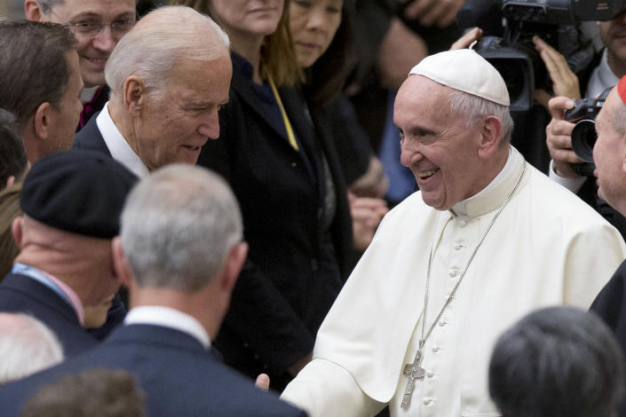 FILE - In this April 29, 2016, file photo Pope Francis shakes hands with Vice President Joe Biden as he takes part in a congress on the progress of regenerative medicine and its cultural impact, being held in the Pope Paul VI hall at the Vatican. President Joe Biden is set to meet Pope Francis when he visits the Vatican later this month as part of a five-day swing through Italy and the U.K. for global economic and climate change meetings. (AP Photo/Andrew Medichini, File)