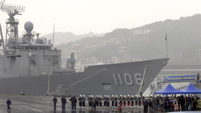"""In this image from a video, sailors and marines stand guard in front of Taiwan's guided-missile frigate at naval base in the northern port of Keelung, Taiwan Monday, March 8, 2021. Taiwanese President Tsai Ing-wen visited the naval base on Monday to thank sailors and marines for their dedication to protecting the island amid renewed threats from China, vowing not to allow the loss of """"any single inch"""" of territory. (AP Photo/Johnson Lai)"""