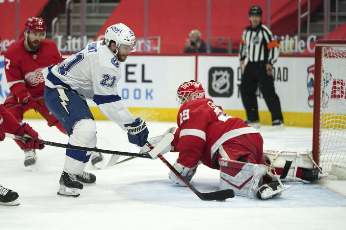 Detroit Red Wings goaltender Thomas Greiss (29) stops a Tampa Bay Lightning center Brayden Point (21) shot in the first period of an NHL hockey game Saturday, May 1, 2021, in Detroit. (AP Photo/Paul Sancya)
