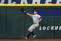 New York Yankees center fielder Brett Gardner reaches out to catch a fly ball by Texas Rangers' Nate Lowe in the first inning of a baseball game in Arlington, Texas, Tuesday, May 18, 2021. (AP Photo/Tony Gutierrez)