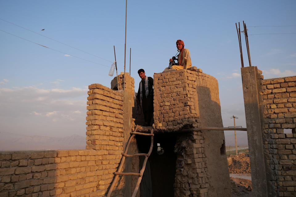 Militia fighters keep watch on a frontline in Siahgerd to the north of Mazar-i-Sharif, Balkh province, where Taliban fighters threatened to breach the city's defences in recent days (Charlie Faulkner)