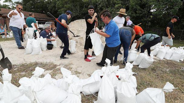 PHOTO: Orange County residents fill sandbags at Blanchard Park in Orlando, Fla., Aug. 28, 2019. The sandbags are being offered in advance of Hurricane Dorian, which is forecast to likely hit Florida. (Stephen M. Dowell/Orlando Sentinel/TNS via Getty Images)