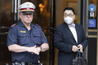 The ambassador of the Permanent Mission of the People's Republic of China to the United Nations, Wang Qun, leaves the 'Grand Hotel Vienna' where where closed-door nuclear talks take place in Vienna, Austria, Saturday, June 12, 2021. (AP Photo/Florian Schroetter)