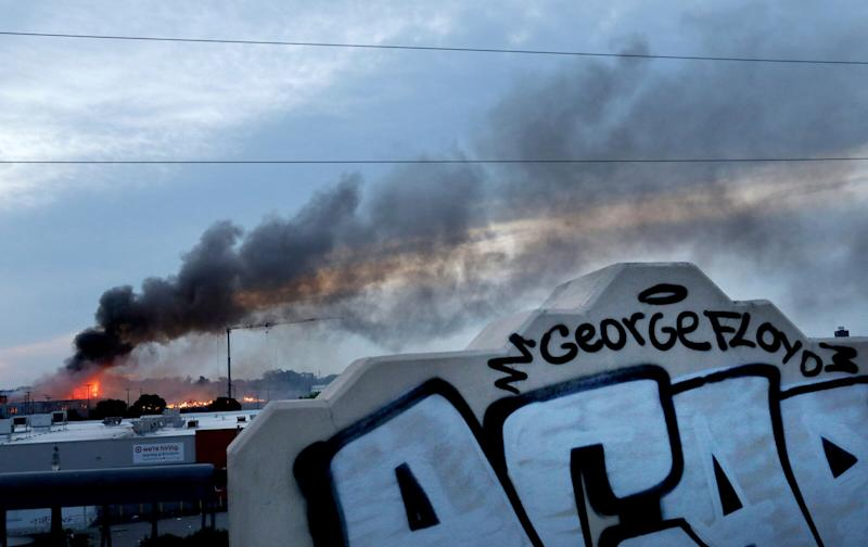 <strong>Smoke fills the sky after a night of unrest and protests in the death of George Floyd early Thursday.</strong> (Photo: ASSOCIATED PRESS)